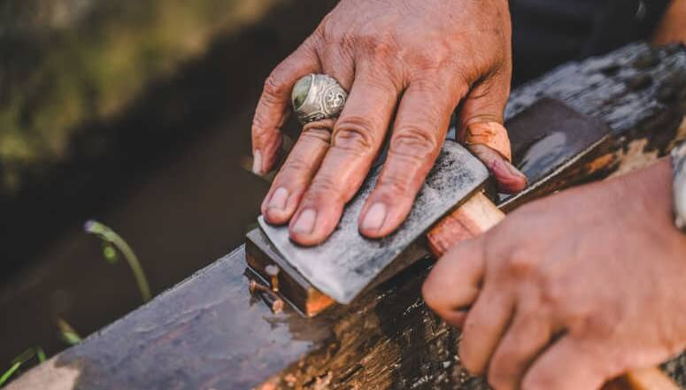 Sharpening Axe By The Hands
