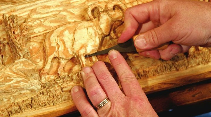 Person Carving Wood