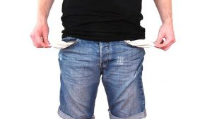 person with empty pockets no money