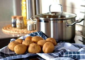stainless steel pot and potatoes