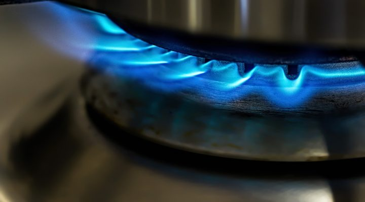 kitchen stovetop with blue flame